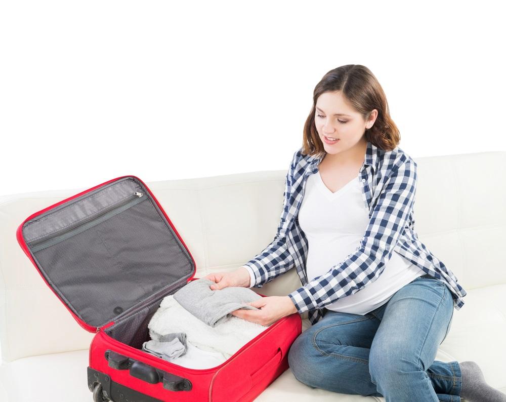 Mamãe arrumando a mala para a Maternidade